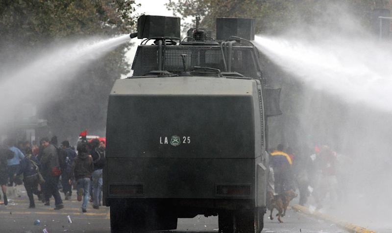 A water cannon in use in Chile: Getty