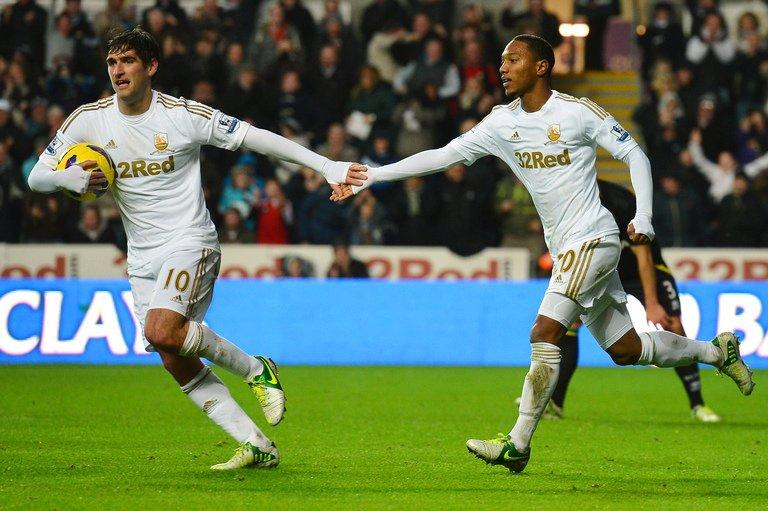 Swansea City midfielder Jonathan de Guzman (R) and Danny Graham at a Premier League match on December 8, 2012. After hosting Manchester United on Sunday, Swansea head to Reading and Fulham before a home game against Aston Villa
