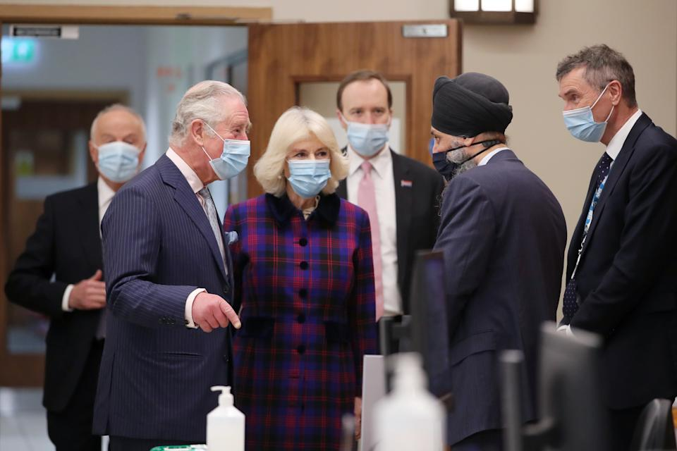 BIRMINGHAM, ENGLAND - FEBRUARY 17: Prince Charles, Prince of Wales and Camilla, Duchess of Cornwall talk with with Chief Pharmacist Inderjit Singh as Health Secretary Matt Hancock looks on during a visit to The Queen Elizabeth Hospital on February 17, 2021 in Birmingham, England. (Photo by Molly Darlington - WPA Pool/Getty Images)
