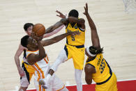 Atlanta Hawks forward Onyeka Okongwu (17) is fouled by Indiana Pacers guard Edmond Sumner (5) during the second half of an NBA basketball game on Sunday, April 18, 2021, in Atlanta. (AP Photo/Brynn Anderson)