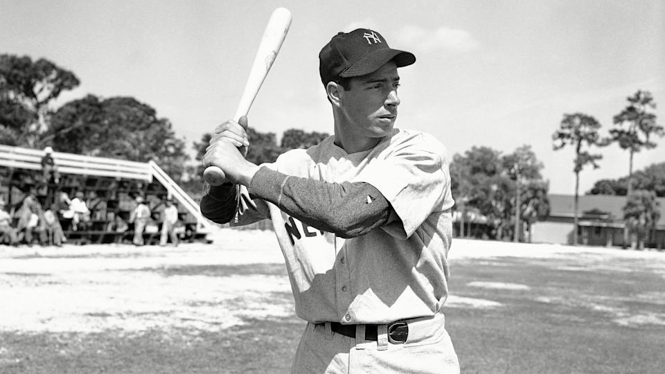 Mandatory Credit: Photo by Preston Stroup/AP/Shutterstock (6663338a)Joe DiMaggio with bat ready at first days workout on in Bradenton, Florida after returning from Panama.