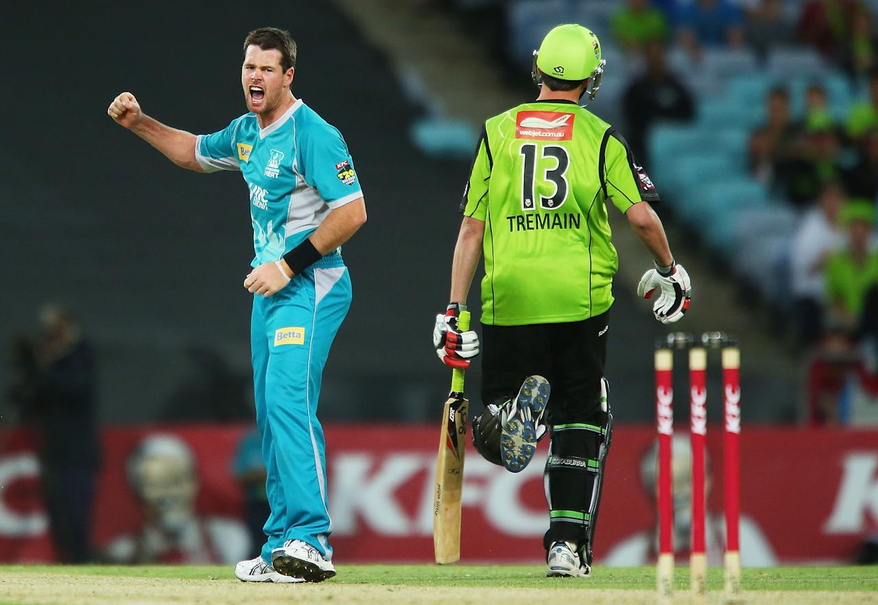SYDNEY, AUSTRALIA - DECEMBER 28:  Dan Christian of the Heat celebrates after claiming the wicket of Chris Tremain of the Thunder during the Big Bash League match between the Sydney Thunder and the Brisbane Heat at ANZ Stadium on December 28, 2012 in Sydney, Australia.  (Photo by Brendon Thorne/Getty Images)