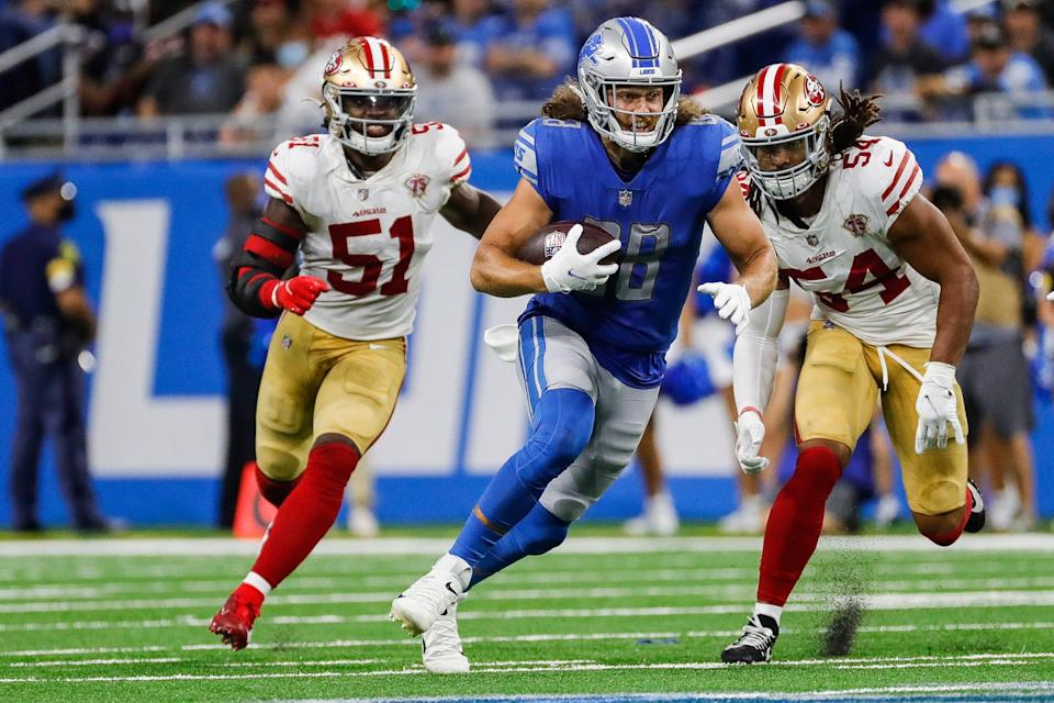 Detroit Lions tight end T.J. Hockenson (88) runs against San Francisco 49ers linebacker Fred Warner (54) during the second half at Ford Field in Detroit on Sunday, Sept. 12, 2021.