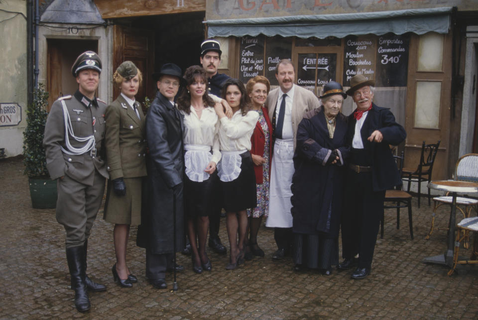 Cast of the television sitcom series 'Allo 'Allo! pictured together on location in Mundford, Norfolk on 22nd April 1986. From left to right: Guy Siner as Lieutenant Gruber, Kim Hartman as Helga, Richard Gibson as Herr Flick, Vicki Michelle as Yvette, Arthur Bostrom as Officer Crabtree, Francesca Gonshaw as Maria, Carmen Silvera as Edith Artois, Gordon Kaye as Rene Artois, Rose Hill as Fanny and Jack Haig as Monsieur Roger LeClerc. (Photo by Larry Ellis Collection/Getty Images)