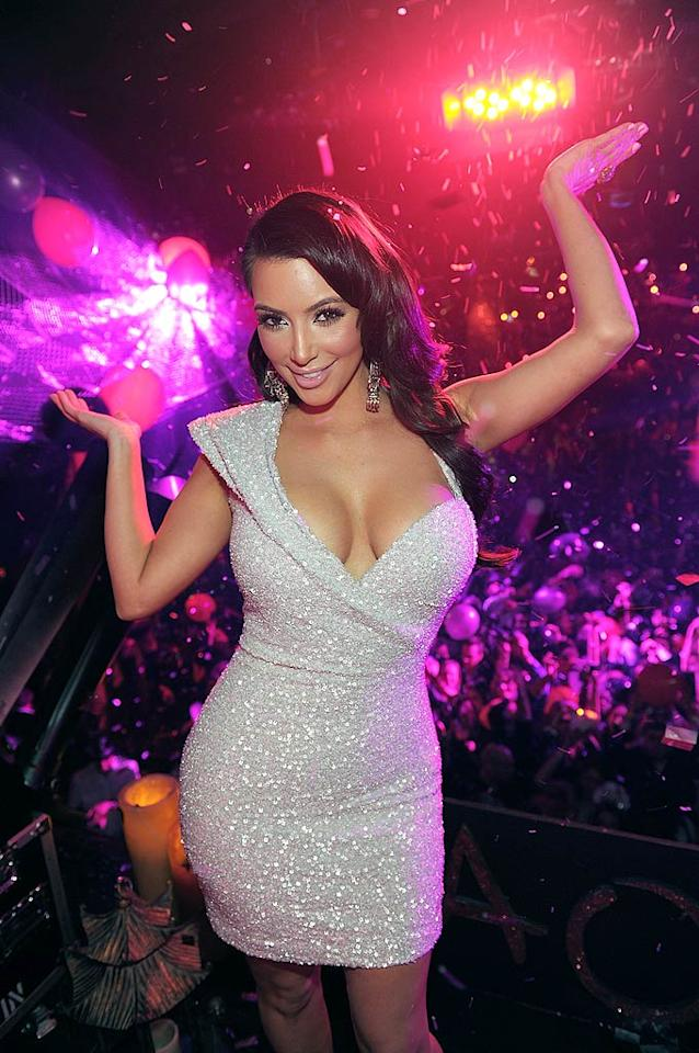 """Just down the road was Kim Kardashian, who surprised club goers at TAO on New Year's Eve with a preview of her debut single, tentatively titled """"Turn It Up."""" """"I didn't mean to, but I did this song with The-Dream, and it's really fun!"""" said Kim of the dance track, adding, """"I hope you guys like it!"""" Denise Truscello/<a href=""""http://www.wireimage.com"""" target=""""new"""">WireImage.com</a> - December 31, 2010"""