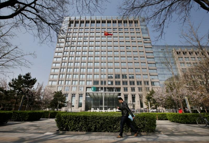 A man walks past the headquarters of Agricultural Bank of China in Beijing