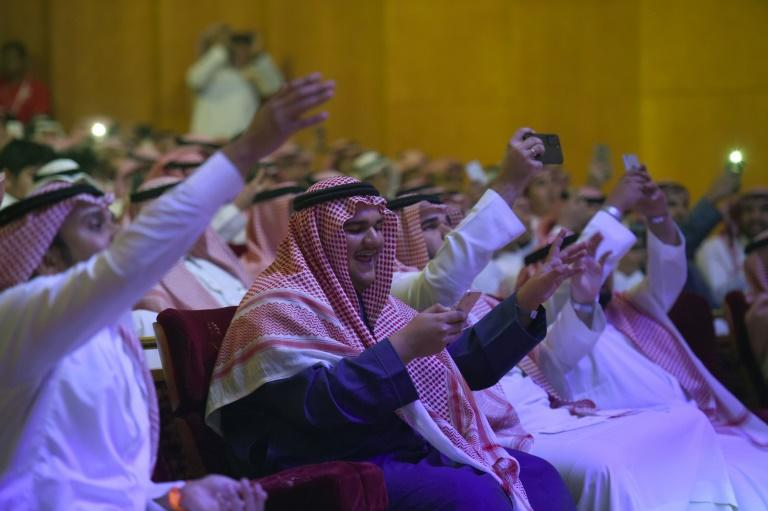Saudis attend a music concert by Rashed Al-Majed in Riyadh on March 9, 2017
