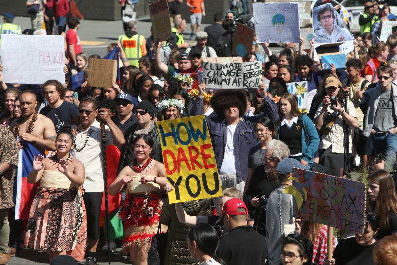 Thousands of people march on Parliament to protest climate change in Wellington, New Zealand, Friday, Sept. 27, 2019. The protest in New Zealand was part of a second wave of protests around the world as the United Nations General Assembly met in New York. (AP Photo/Nick Perry)