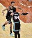 Memphis Grizzlies forward Kyle Anderson (1) and guard Dillon Brooks (24) celebrate during the second half of the team's NBA basketball game against the Los Angeles Clippers on Thursday, Feb. 25, 2021, in Memphis, Tenn. (AP Photo/Brandon Dill)