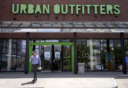A customer leaves the Urban Outfitters store in Denver May 14, 2015. REUTERS/Rick Wilking