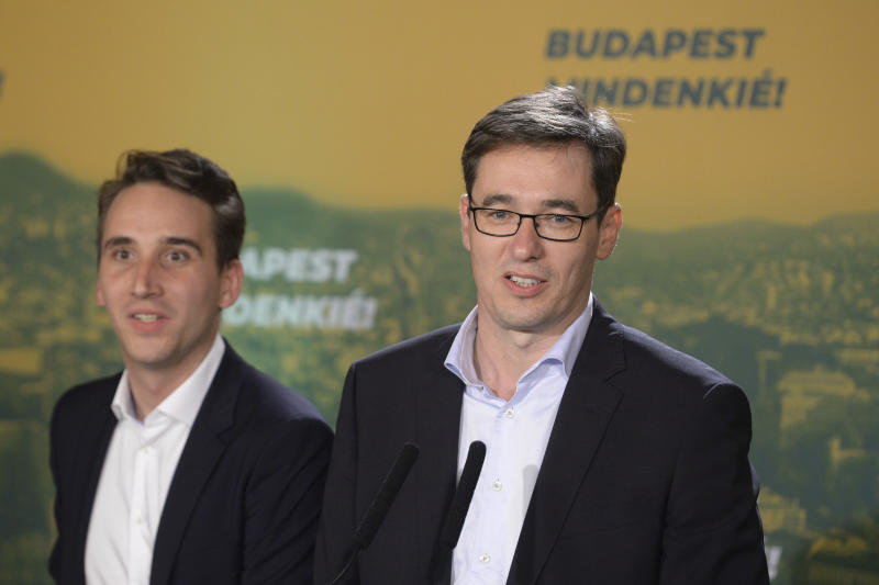 Newly elected Mayor of Budapest Gergely Karacsony, right, candidate of most of the oppositional parties speaks during the parties' event after the nationwide local elections in Budapest, Hungary, Sunday, October 13, 2019. (Zoltan Balogh/MTI via AP)