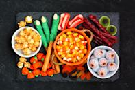"""<p>Whether sweet or savory - or both! - snack boards are the most fun current trend to get in on, especially during the spooky season. Create a <a href=""""https://www.popsugar.com/food/halloween-charcuterie-boards-47703856"""" class=""""link rapid-noclick-resp"""" rel=""""nofollow noopener"""" target=""""_blank"""" data-ylk=""""slk:Halloween-themed charcuterie board"""">Halloween-themed charcuterie board</a> with your kids' faovrite meats, cheeses, crackers, and more; or create a sugary candy board and pick at it during a movie as a treat!</p>"""