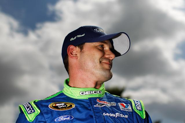 DAYTONA BEACH, FL - FEBRUARY 19: Casey Mears, driver of the #13 GEICO Ford, looks on after qualifying for the NASCAR Sprint Cup Series Daytona 500 at Daytona International Speedway on February 19, 2012 in Daytona Beach, Florida. (Photo by Tom Pennington/Getty Images for NASCAR)