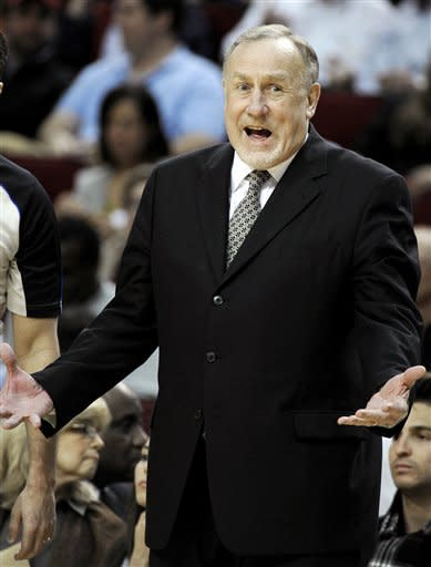 Minnesota Timberwolves coach Rick Adelman questions a call in the first half of an NBA basketball game against the Houston Rockets, Monday, Jan. 30, 2012, in Houston. (AP Photo/Pat Sullivan)