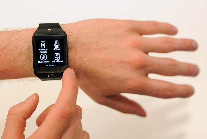 A Samsung employee demonstrates the new SM-R381 Smartwatch, during the Tizen Developer Conference in San Francisco, California, on June 3, 2014