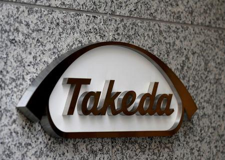 FILE PHOTO: Takeda Pharmaceutical Co's logo is seen at its new headquarters in Tokyo, Japan, July 2, 2018. REUTERS/Kim Kyung-Hoon/File Photo