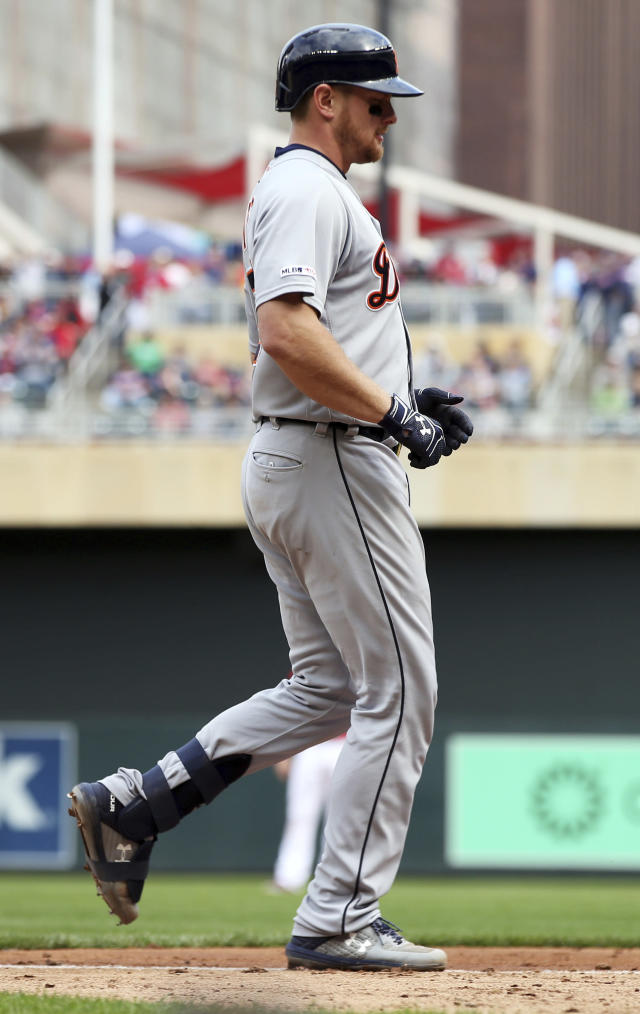 Detroit Tigers' John Hicks jogs home after hitting a tie-breaking home run off Minnesota Twins relief pitcher Trevor Hildenberger in the ninth inning in the first baseball game of a doubleheader, Saturday, May 11, 2019, in Minneapolis. The Tigers won 5-3. (AP Photo/Jim Mone)