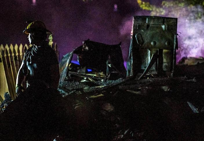 Raytown firefighters and police look over the scene after a duplex exploded in the 7500 block of Englewood Avenue, Monday, June 28, 2021 in Raytown. The cause of the fire is still under investigation.