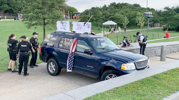 PHOTO: Park Police officers respond to the Washington Monument grounds where a vehicle had struck the security barrier located in the northeast quadrant of the Washington Monument grounds, July 3, 2021. (Arsen Hoxha / Twitter)