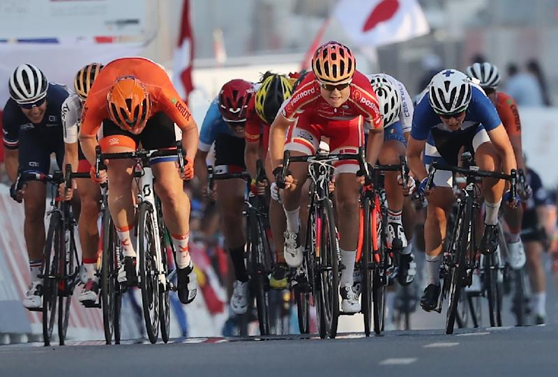 Denmark's Amalie Dideriksen (C) competes to win the women's elite road race event as part of the 2016 UCI Road World Championships on October 15, 2016, in the Qatari capital Doha. (AFP Photo/KARIM JAAFAR)