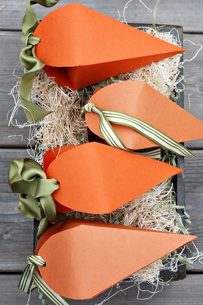 """<p>The perfect size for your little bunnies, these carrot-shaped containers are a fun take on traditional plastic eggs.</p><p><a href=""""http://www.ellaclaireinspired.com/easter-carrot-favor-boxes-free-printable/"""" rel=""""nofollow noopener"""" target=""""_blank"""" data-ylk=""""slk:Get the tutorial from Ella Claire »"""" class=""""link rapid-noclick-resp""""><em>Get the tutorial from Ella Claire »</em></a></p>"""