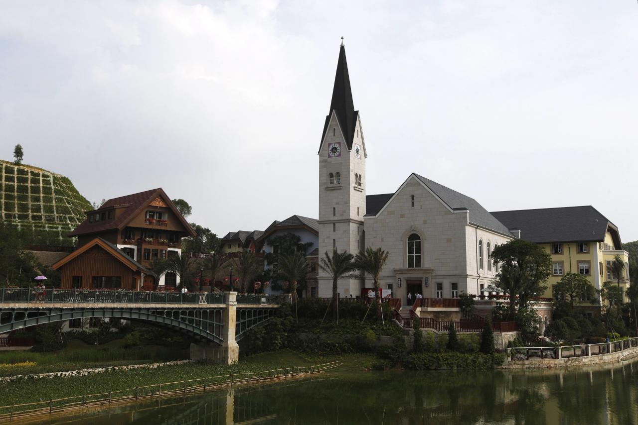A general view of a replica of Austria's UNESCO heritage site, Hallstatt village in China's southern city of Huizhou in Guangdong province June 1, 2012. Metals and mining company China Minmetals Corporation spent $940 million to build this controversial site and hopes to attract both tourists and property investors alike, according to local newspaper reports. REUTERS/Tyrone Siu (CHINA - Tags: BUSINESS SOCIETY)