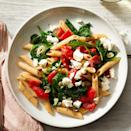 """<p>In this quick 20-minute dinner recipe, tender penne pasta is combined with garlic, roasted red peppers and spinach and topped with crumbled feta cheese for a fast and easy Mediterranean-inspired meal. This recipe was graciously shared by EatingWell reader Dottie Carpenter, who states, """"Recipes are no good if they're not shared!""""</p>"""