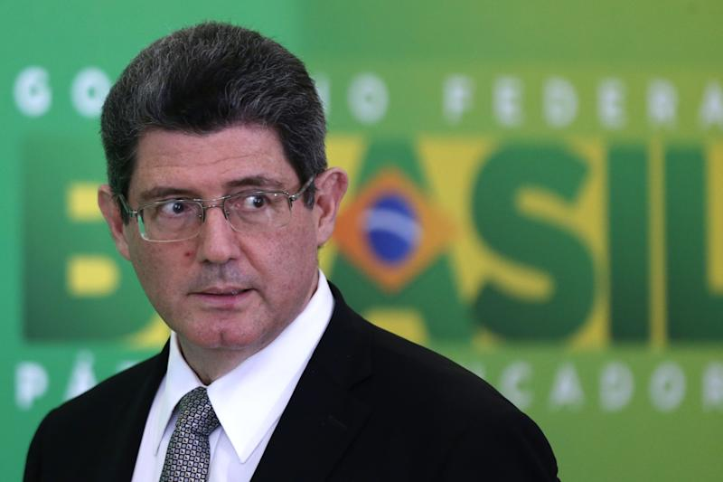 Brazil's Finance Minister Joaquim Levy arrives to attends a press conference on spending cuts and new taxes as part of the fiscal reform at the Planalto Presidential Palace, in Brasilia, Brazil, Monday, Sep. 14, 2015. Levy says the cuts are to include large-scale infrastructure projects initially aimed at stimulating the South American giant's now-stalling economy, as well as personnel cuts within Cabinet ministry staff, and other cuts to Brazil's bloated public sector. (AP Photo/Eraldo Peres)