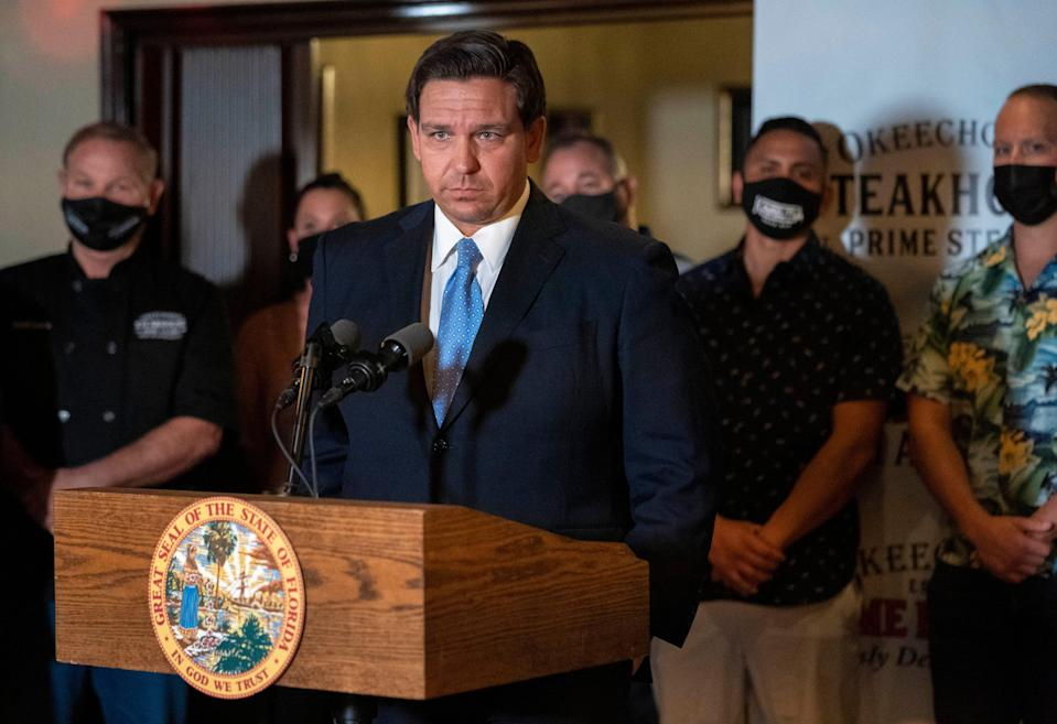Florida Governor Ron DeSantis speaks during a press conference at the Okeechobee Steakhouse on December 15, 2020 in West  Palm Beach, Florida. DeSantis talked about the importance of keeping restaurants open during the pandemic  to help employees earn a living.