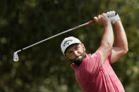 Jon Rahm hits from the fairway on the third hole during the final round of play in the Tour Championship golf tournament at East Lake Golf Club, Sunday, Sept. 5, 2021, in Atlanta. (AP Photo/Brynn Anderson)