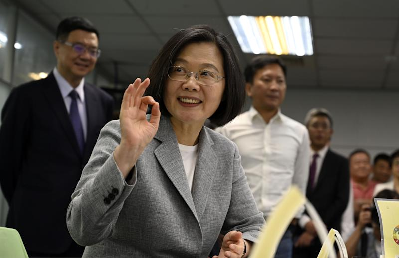 Taiwan's President Tsai Ing-wen gestures while registering as the ruling Democratic Progressive Party (DPP) 2020 presidential candidate at the party's headquarter in Taipei on March 21, 2019. (Photo by SAM YEH / AFP) (Photo credit should read SAM YEH/AFP/Getty Images)
