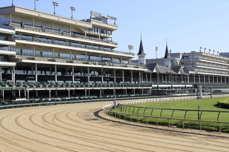 The empty stands at Churchill Downs.