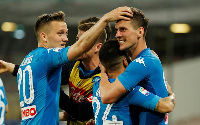 Soccer Football - Serie A - Napoli vs Udinese Calcio - Stadio San Paolo, Naples, Italy - April 18, 2018 Napoli's Arkadiusz Milik celebrates with Lorenzo Insigne and Piotr Zielinski after scoring their third goal REUTERS/Ciro De Luca