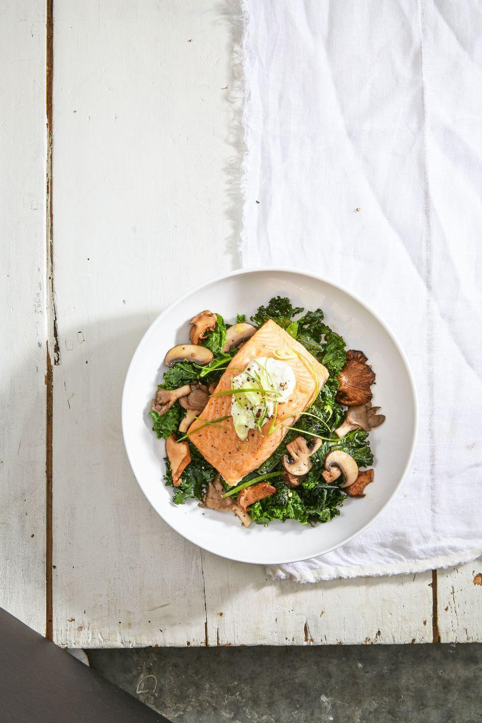 """<p>This Nordic-inspired salmon dish is hearty, healthy, and so delicious.</p><p><em><a href=""""https://www.goodhousekeeping.com/food-recipes/easy/a36252/salmon-with-skyr-and-sauteed-kale/"""" rel=""""nofollow noopener"""" target=""""_blank"""" data-ylk=""""slk:Get the recipe for Salmon with Skyr and Sautéed Kale »"""" class=""""link rapid-noclick-resp"""">Get the recipe for Salmon with Skyr and Sautéed Kale »</a></em> </p>"""