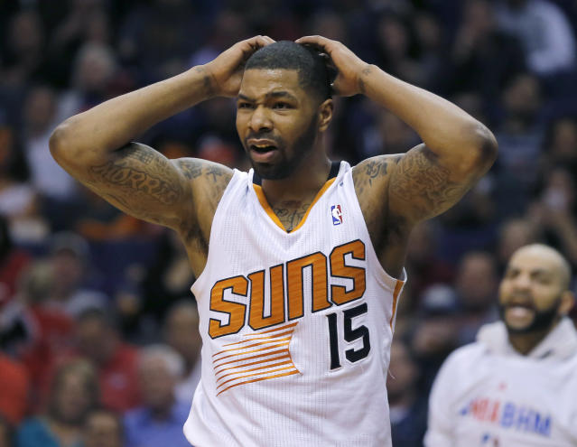 Phoenix Suns' Marcus Morris reacts to a call during the first half of an NBA basketball game against the Chicago Bulls, Tuesday, Feb. 4, 2014, in Phoenix. (AP Photo/Matt York)