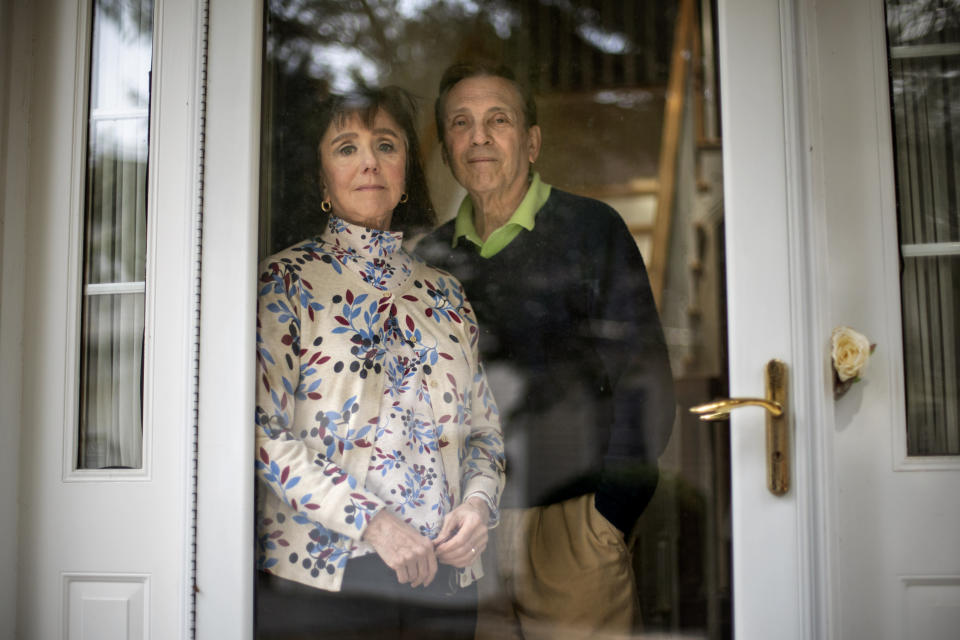 "L. Shapley Bassen, left, is photographed with her husband, Michael, in their home in East Greenwich, R.I., Thursday, March 11, 2021. The road to a COVID-19 shot often leads through a maze of scheduling systems: Some vaccine seekers spend days or weeks trying to book online appointments. Those who get a coveted slot can still be stymied by pages of forms or websites that slow to a crawl and crash. The technological obstacles are familiar to Bassen, a 74-year-old retired English teacher and editor. She lost track of the hours she spent making phone calls and navigating websites to get appointments for herself and her 75-year-old husband, Michael. ""A lot of us don't sleep at night worrying about whether or not we'll be able to get in,"" she said. (AP Photo/David Goldman)"
