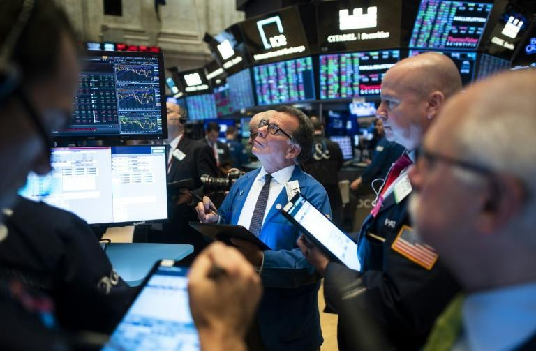 Last week, the Dow had edged to a fresh record high but the Nasdaq retreated after 10 straight all-time highs (AFP Photo/Johannes EISELE)