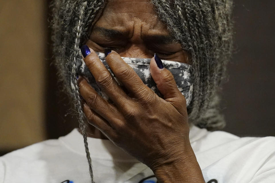 Cheryl Lewis, sister of Byron Williams, cries during a news conference, Thursday, July 15, 2021, in Las Vegas. The family of 50-year-old Byron Williams, whose death in Las Vegas police custody after a bicycle chase in 2019 was ruled a homicide, is suing the city and four officers they accuse of wrongful death and civil rights violations. (AP Photo/John Locher)