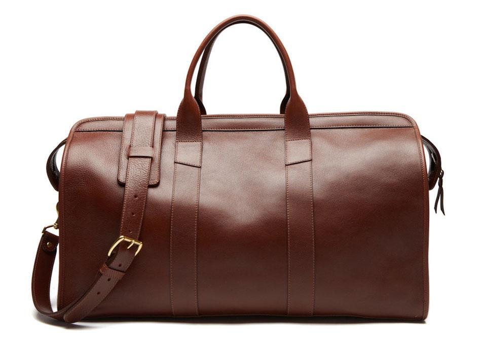 """<p>Lotuff Leather Duffle Travel Bag, $1,050, <a href=""""http://lotuffleather.com/collections/duffles/products/leather-duffle-travel-bag"""" rel=""""nofollow noopener"""" target=""""_blank"""" data-ylk=""""slk:lotuffleather.com"""" class=""""link rapid-noclick-resp"""">lotuffleather.com</a></p>"""
