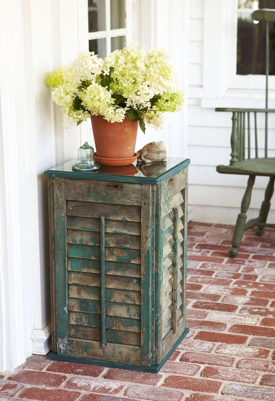 """<p>Skip painting and embrace a weathered finish when making this side table, made out of old farmhouse shutters. </p><p><em><a href=""""https://www.goodhousekeeping.com/home/craft-ideas/how-to/a19239/how-to-build-a-table/"""" rel=""""nofollow noopener"""" target=""""_blank"""" data-ylk=""""slk:Get the tutorial »"""" class=""""link rapid-noclick-resp"""">Get the tutorial »</a></em> </p>"""