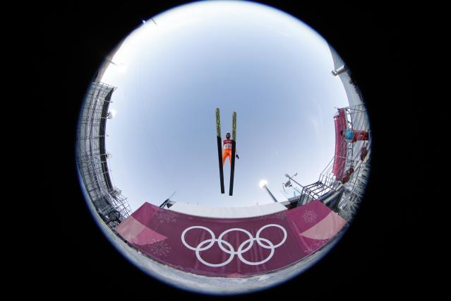 Nordic Combined Events - Pyeongchang 2018 Winter Olympics - Team LH Training - Alpensia Ski Jumping Centre - Pyeongchang, South Korea - February 21, 2018 - A forejumper in action. Picture taken with a fisheye lens. REUTERS/Jorge Silva