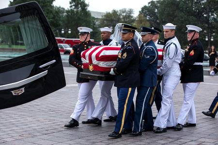 Joint service members of a military casket team carry the casket of Senator John McCain from the US Capitol to a motorcade that will ferry him to a funeral service at the National Cathedral in Washington, DC, USA, 01 September 2018. McCain died 25 August, 2018 from brain cancer at his ranch in Sedona, Arizona, USA. He was a veteran of the Vietnam War, served two terms in the US House of Representatives, and was elected to five terms in the US Senate. McCain also ran for president twice, and was the Republican nominee in 2008.   Jim Lo Scalzo/POOL Via REUTERS