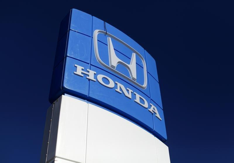 A Honda dealership sign is shown at a car lot in Carlsbad, California
