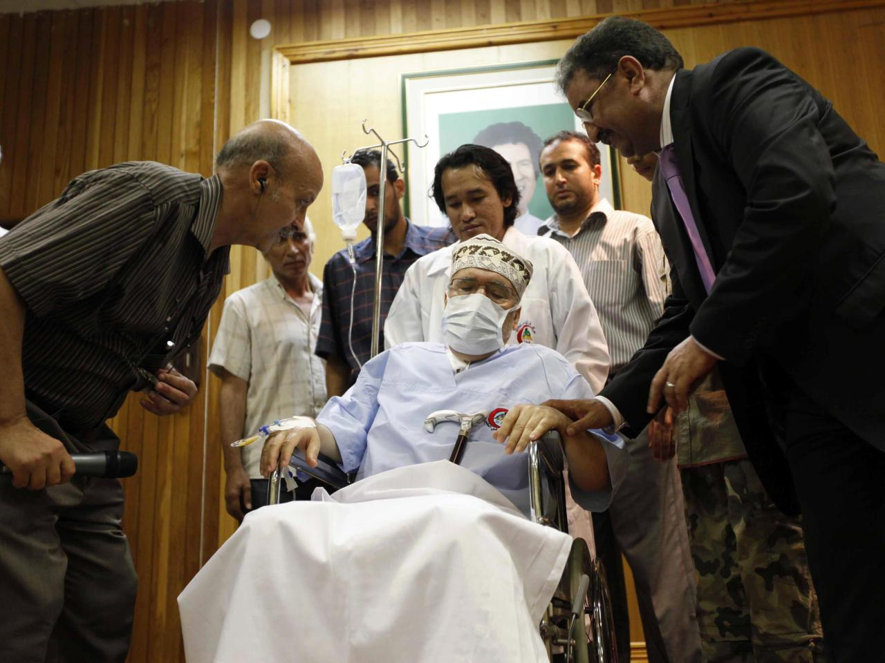 Abdel Basset al-Megrahi sits in a wheelchair in his room at a hospital in Tripoli September 9, 2009. The dying Libyan convicted of the 1988 Lockerbie bombing and freed on compassionate grounds despite U.S. objections was met by African parliamentary deputies on Wednesday in an apparent public show of support. REUTERS/Ismail Zetouny
