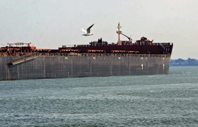 A ship on its way near Egypt's Suez Canal on March 30, 2021, a day after passage of the waterway was made possible once more by the dislodging of a giant container ship