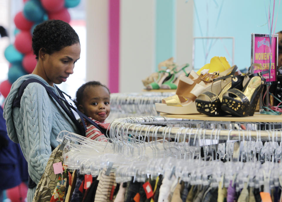 IMAGE DISTRIBUTED FOR AIDS HEALTHCARE FOUNDATION - Marcella Jackson, of Columbus, shops with her son Evan during the grand opening of AIDS Healthcare Foundation's Out of the Closet thrift store Saturday, Oct. 19, 2013, in Columbus, Ohio. The facility is AHF's first retail fundraising and pharmacy operation in Ohio and will serve as a hub for the organization's HIV/AIDS advocacy in the region. (Jay LaPrete/AP Images for AIDS Healthcare Foundation)