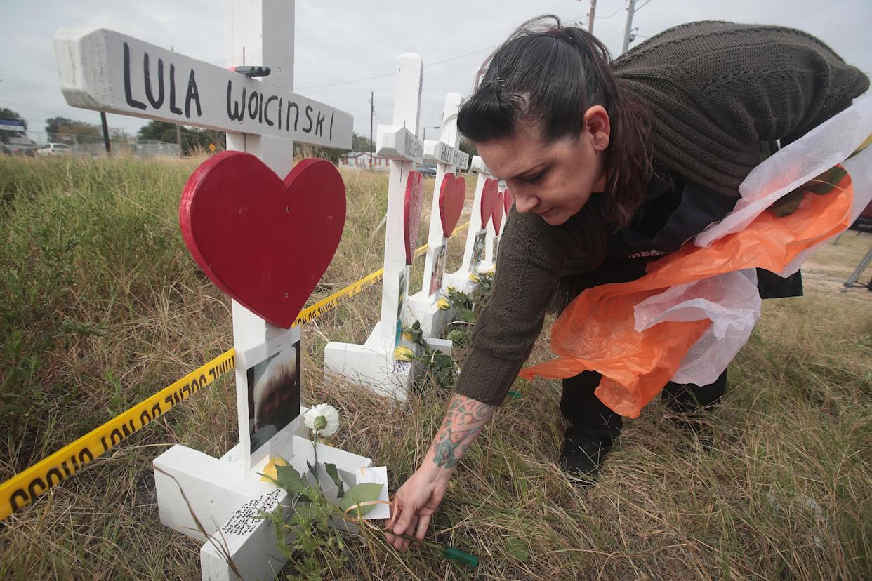 Joyce Mires leaves flowers at Lula Woicinski's memorial. (Photo: Scott Olson/Getty Images)