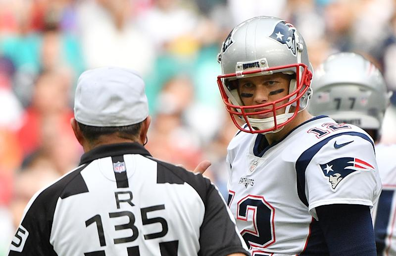 MIAMI, FL - DECEMBER 09: Tom Brady #12 of the New England Patriots talks to referee Pete Morelli #135 in the first half against the Miami Dolphins at Hard Rock Stadium on December 9, 2018 in Miami, Florida. (Photo by Mark Brown/Getty Images)