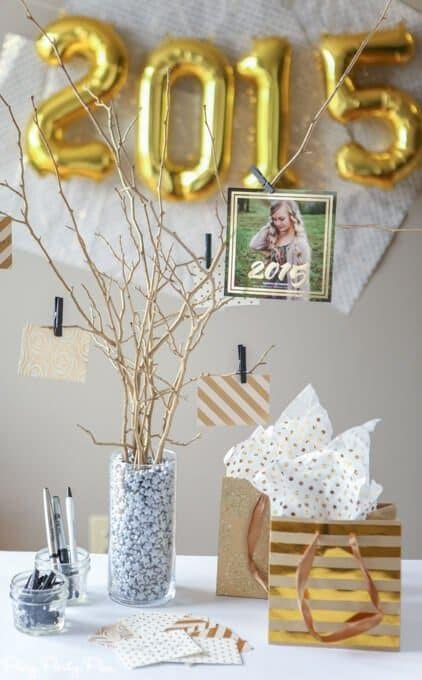 "<p>Here's a sentimental accent you can add to the party. Display gold spray-painted branches in a vase, set out some paper and pens, and ask guests to share their best pieces of advice for the graduate, which will be hung from the tree using mini clothespins. </p><p><strong>Get the tutorial at <a href=""https://www.playpartyplan.com/graduation-party-ideas-diy-graduation-advice-tree"" rel=""nofollow noopener"" target=""_blank"" data-ylk=""slk:Play Party Plan"" class=""link rapid-noclick-resp"">Play Party Plan</a>.</strong></p><p><a class=""link rapid-noclick-resp"" href=""https://go.redirectingat.com?id=74968X1596630&url=https%3A%2F%2Fwww.walmart.com%2Fip%2FRUST-OLEUM-355100-Spray-Paint-Metallic-Gold-11-oz%2F224574914&sref=https%3A%2F%2Fwww.thepioneerwoman.com%2Fhome-lifestyle%2Fentertaining%2Fg36014713%2Fgraduation-party-ideas%2F"" rel=""nofollow noopener"" target=""_blank"" data-ylk=""slk:SHOP GOLD SPRAY PAINT"">SHOP GOLD SPRAY PAINT</a></p>"