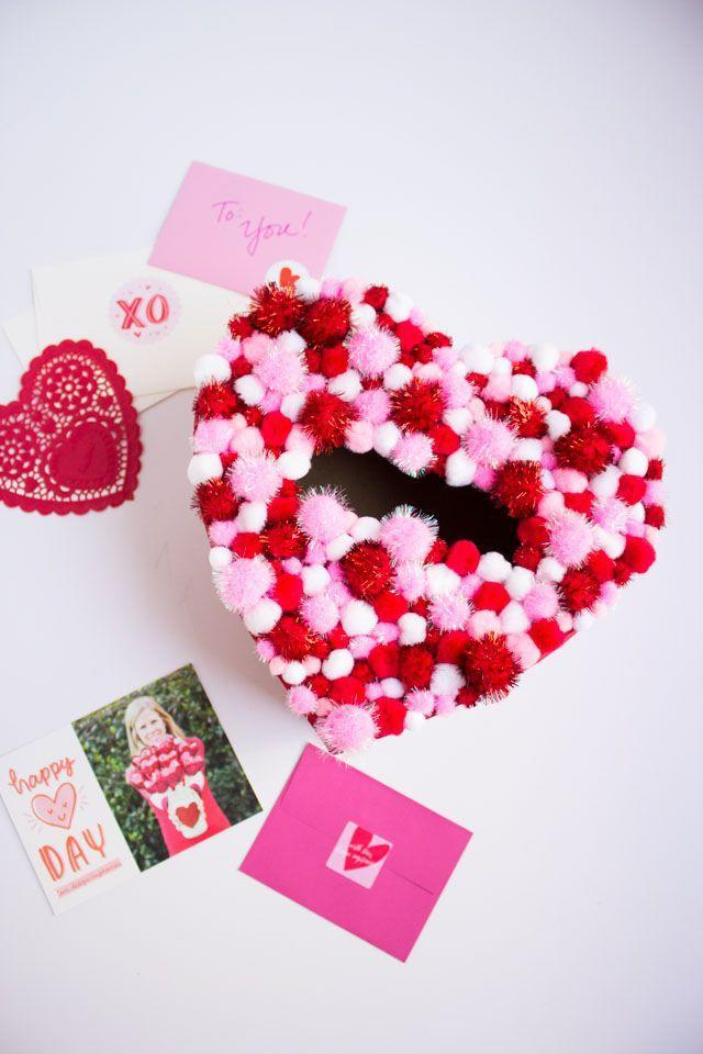 "<p>It doesn't get more cheery than this pom-pom-loaded box that will get your child in the Valentine's Day spirit immediately.</p><p><strong>Get the tutorial at <a href=""https://designimprovised.com/2016/02/diy-pom-pom-heart-valentine-card-holder-box.html"" rel=""nofollow noopener"" target=""_blank"" data-ylk=""slk:Design Improvised"" class=""link rapid-noclick-resp"">Design Improvised</a>.</strong></p><p><a class=""link rapid-noclick-resp"" href=""https://www.amazon.com/Factory-Direct-Craft-Ready-Personalize/dp/B00DJ8FXCU/ref=sr_1_54?tag=syn-yahoo-20&ascsubtag=%5Bartid%7C10050.g.25844424%5Bsrc%7Cyahoo-us"" rel=""nofollow noopener"" target=""_blank"" data-ylk=""slk:SHOP HEART BOXES"">SHOP HEART BOXES</a><strong><br></strong></p>"